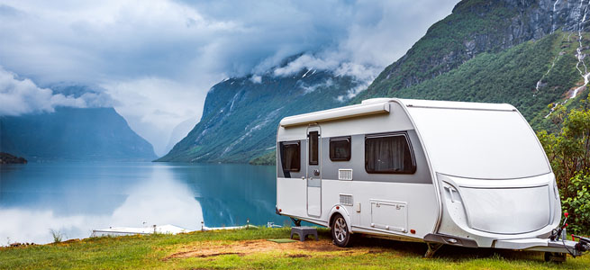 caravan parked in scenic location in the mountains