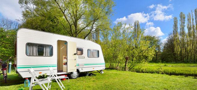 Caravan in a sunny field