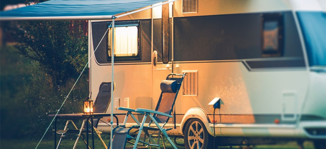 Caravan at caravan park with camping chairs